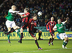 Hibs v St Johnstone....21.12.13    SPFL<br /> James Collins gets above Frazer Wright and Sanil Jahic only to see his header saved by Alan Mannus<br /> Picture by Graeme Hart.<br /> Copyright Perthshire Picture Agency<br /> Tel: 01738 623350  Mobile: 07990 594431