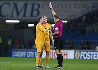 Tom Clarke (captain) of Preston North End confronts referee Graham Scott with team mate Aiden McGeady during the Sky Bet Championship match between Cardiff City and Preston North End at Cardiff City Stadium, Wales, UK. Tuesday 31 January 2017