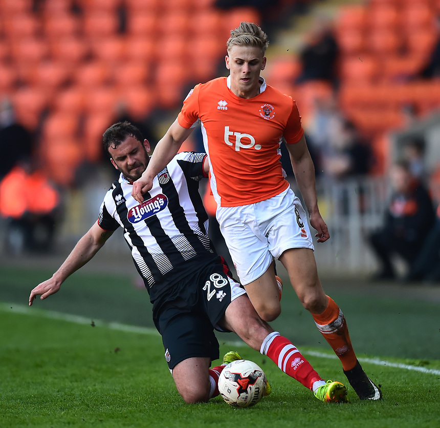 Blackpool's Brad Potts is tackled by Grimsby Town's Gavin Gunning<br /> <br /> Photographer Richard Martin-Roberts/CameraSport<br /> <br /> The EFL Sky Bet League Two - Blackpool v Grimsby Town - Saturday 8th April 2017 - Bloomfield Road - Blackpool<br /> <br /> World Copyright &copy; 2017 CameraSport. All rights reserved. 43 Linden Ave. Countesthorpe. Leicester. England. LE8 5PG - Tel: +44 (0) 116 277 4147 - admin@camerasport.com - www.camerasport.com