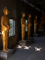 Buddha statues inside the Temple area and Monastery at Aek Phnom Angkorian, 11th Century Battambang Cambodia,
