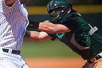 Dartmouth Big Green catcher Adam Gauthier (18) tags out Mike Mioduszewski (15) attempting to score a run during a game against the Eastern Michigan Eagles on February 25, 2017 at North Charlotte Regional Park in Port Charlotte, Florida.  Dartmouth defeated Eastern Michigan 8-4.  (Mike Janes/Four Seam Images)