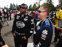 Aug. 4, 2013; Kent, WA, USA: NHRA top fuel dragster driver Brandon Bernstein (right) stands with Shawn Langdon during the Northwest Nationals at Pacific Raceways. Mandatory Credit: Mark J. Rebilas-USA TODAY Sports
