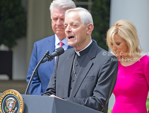 Cardinal Donald Wuerl, the archbishop of Washington offers a prayer prior to United States President Donald J. Trump signing a Proclamation designating May 4, 2017 as a National Day of Prayer and an Executive Order &quot;Promoting Free Speech and Religious Liberty&quot; in the Rose Garden of the White House in Washington, DC on Thursday, May 4, 2017.<br /> Credit: Ron Sachs / CNP