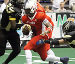 SIOUX FALLS, SD - JUNE 23:  Chris Dixon #2 from the Sioux Falls Storm scampers past a pair of defenders from the Lee Valley Steelhawks in the first quarter of their first round playoff game Saturday night at the Sioux Falls Arena. (Photo by Dave Eggen/Inertia)