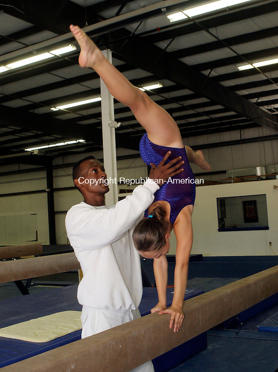 NEW MILFORD, CT-10August 2006-081006TK04- Serena Shaw, 11, of Litchfield working on her gymnastic routines assisted by her coach Russell Wallace, at the Elite Gymnastic Center in New Milford. Tom Kabelka Republican-American (Serena Shaw, Russell Wallace, gymnastic routines)