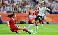 Kim Kulig (r) of Germany and Emily Zurrer of Canada during the FIFA Women's World Cup at the FIFA Stadium in Berlin, Germany on June 26th, 2011.