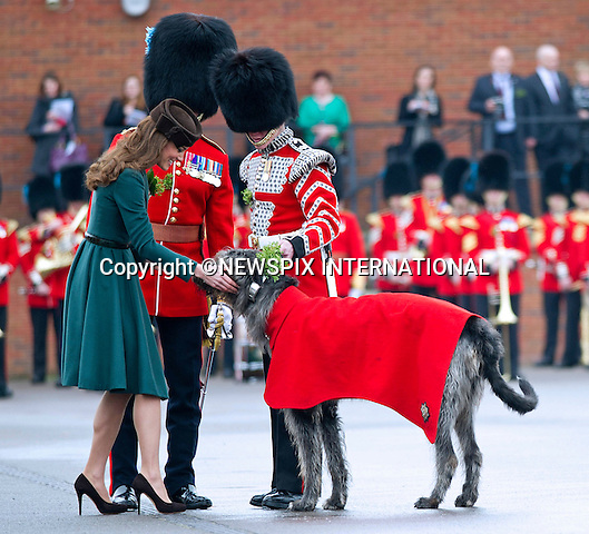 """KATE PRESENTS SHAMROCKS TO IRISH GUARDS.The Duchess of Cambridge presented shamrocks to members of 1 Irish Guards at Mons Barracks in Aldershot to mark the occasion of St Patricks Day_17/03/2012.Mandatory Credit Photo: ©A Baskerville/NEWSPIX INTERNATIONAL..**ALL FEES PAYABLE TO: """"NEWSPIX INTERNATIONAL""""**..IMMEDIATE CONFIRMATION OF USAGE REQUIRED:.Newspix International, 31 Chinnery Hill, Bishop's Stortford, ENGLAND CM23 3PS.Tel:+441279 324672  ; Fax: +441279656877.Mobile:  07775681153.e-mail: info@newspixinternational.co.uk"""