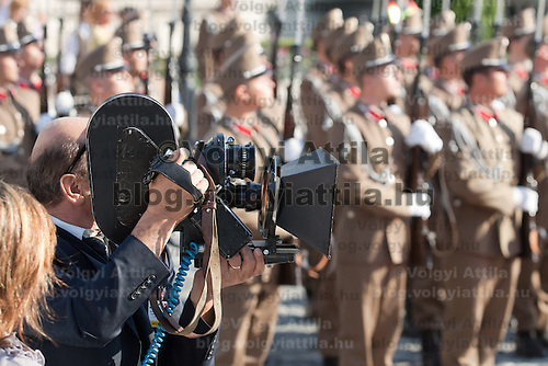 Member of the Tajik press prepares to record with his analogue film camera President of Tajikistan Emomali Rahmon (not pictured) and his Hungarian counterpart Pal Schmitt (not pictured) inspect the guard of honor during a welcoming ceremony in Budapest, Hungary on June 10, 2011. ATTILA VOLGYI.Emomali Rahmon is in Hungary fro a two-day official visit.