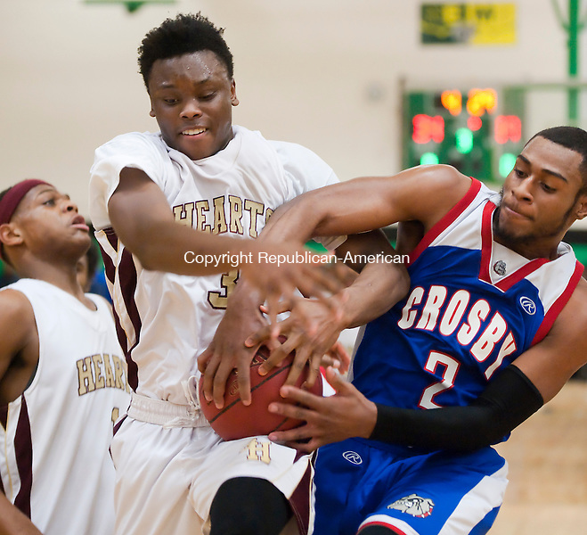 WATERBURY,  CT-030415JS12- Sacred Heart's Mustapha Heron (3) and Crosby's Zarvon Love (2) battle for a rebound during their NVL Tournament championship game Wednesday at Wilby High School in Waterbury. <br /> Jim Shannon Republican-American