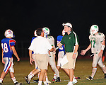 J.T. Curtis of the John Curtis Patriots and Head Coach Nelson Stewart of Newman exchange congratulations at the end of the game. Curtis defeated Newman 34-7.