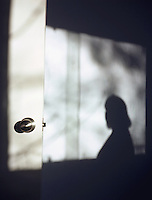 Woman's shadow projected on wall
