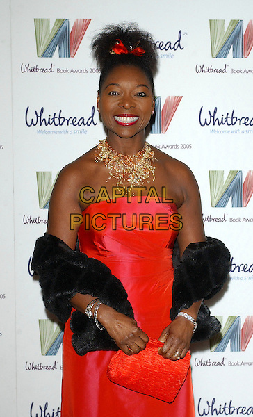 FLOELLA BENJAMIN.The Whitbread Book Of The Year Awards 2005, The Brewery, Chiswell Street, London, UK..January 24th, 2006.Ref: BEL.half length red ribbon in hair necklace pearls jewellery red strapless dress black scarf wrap shawl clutch purse.www.capitalpictures.com.sales@capitalpictures.com.© Capital Pictures.