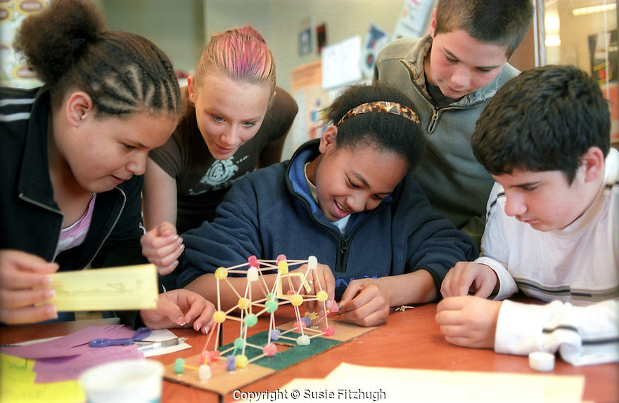 Using candy and toothpicks, middle school students work together to build geometric shapes.