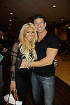 """Gina Marie Zimmerman (Big Brother) poses with Paul Logan (Days """"Glen Reiber"""" as they attended Chiller Theatre Spring Extravaganza was held on April 27, 2014 at the Parsippany Sheraton Hotel in Parsippany, New Jersey.  (Photo by Sue Coflin/Max Photos)"""