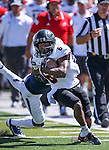 Southern Utah's Chris Robinson (6) runs past Nevada defender Kaodi Dike (3) during the second half of an NCAA college football game on Saturday, Aug. 30, 2014 in Reno, Nev. (AP Photo/Cathleen Allison)