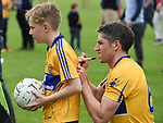 Gordon Kelly of Clare signs a jersey for Julian Linnane of Kilmurry Mc Mahon following their Munster championship quarter-final game against Limerick in Cusack park. Photograph by John Kelly.