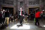 Sen. Mark Warner, D-Va., walks through the Rotunda from the House to the Senate side in the Capitol on Thursday, March 13, 2014. (Photo By Bill Clark/CQ Roll Call)
