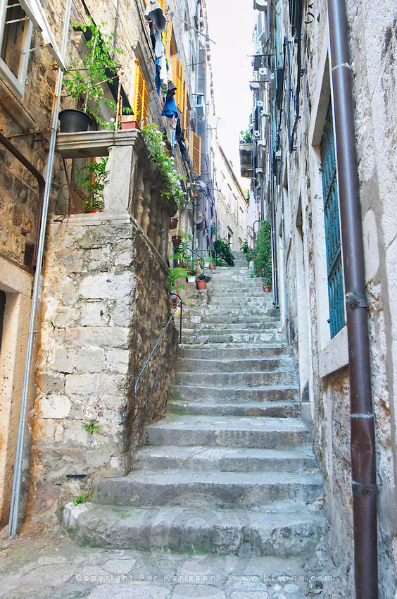 View from the Prijeko street up a narrow side street with steep stairs. Narrow cobble stone street. Dubrovnik, old city. Dalmatian Coast, Croatia, Europe.