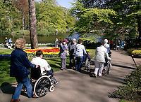 Mensen in een rolstoel