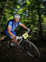 STAFF PHOTO BEN GOFF  @NWABenGoff -- 09/07/14 Mark Fiegel competes in the Category 1 age 40-49 race during Slaughter Pen Jam, part of the Arkansas Mountain Bike Championship Series, on the Slaughter Pen trails in Bentonville on Sunday September 7, 2014.