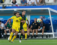 GRENOBLE, FRANCE - JUNE 18: Toriana Patterson #19 of the Jamaican National Team attempts to control the ball as Chloe Logarzo #6 of the Australian National Team pressures during a game between Jamaica and Australia at Stade des Alpes on June 18, 2019 in Grenoble, France.