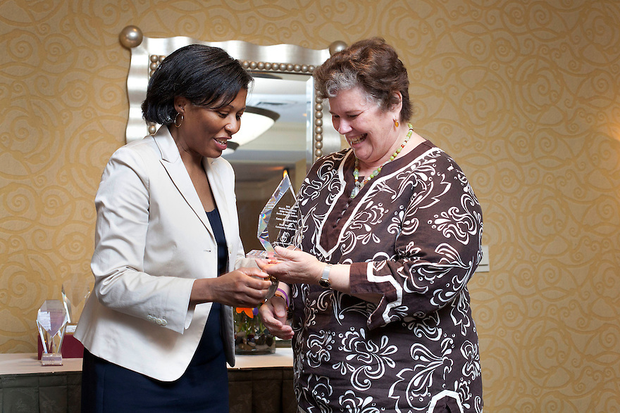 April Hawkins gives Karen Dahl her award at the Older Volunteers Enrich America Awards at the Double Tree Hotel in Washington, DC on Friday, June 17, 2011.