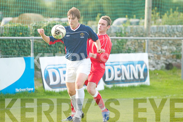 Ger Lovett, Lisselton,.heads down the ball.with Maurice.ORahilly, Tralee.Dynamos, close behind.