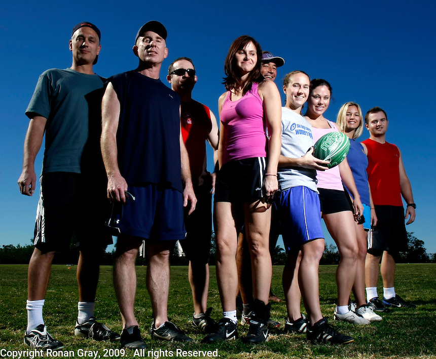 Saturday, 01/17/09:  San Diego, California, USA:  A group of players poses before a mixed game of touch rugby at Torrey Highlands Park in Del Mar.  An informal group of players meets every Saturday morning at 11am for games.  The sport of Touch Rugby is a fast paced, exciting version of the full contact game that is gaining popularity in San Diego.  As the name suggests, the &quot;touch&quot; version is not a full contact game.  Players are only allowed to make contact by hand with opposing players while they have possesion of the ball.  Possesion passes to the defending team after a score or if six &quot;touches&quot;  have been made while the attacking team moves the ball towards the goal line.  Pick-up games can be found most Saturdays in the Del Mar Park and on Sunday mornings at the beach in Del Mar or Sunday afternoons in South Mission Beach.  From left:  Ben Seville, John Schleimer, Tim O'Hara, Ruth Oram, Mark Sloan, Mandy Wilson, Jessica Wheatcraft, Carolyn Peterson and <br /> Jacobus Breytenbach.