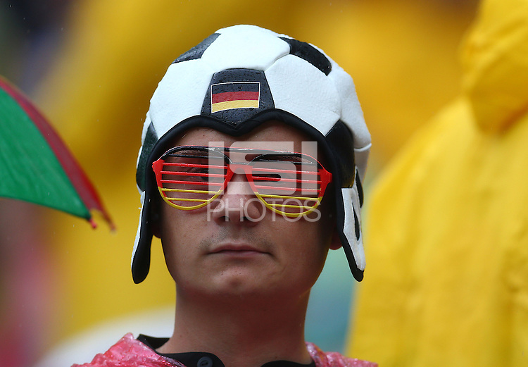 A Germany supporter with a football themed hat