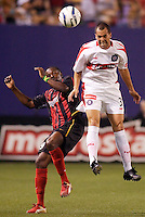 The Chicago Fire's Evan Whitfield goes for a header as the MetroStars' Fabian Taylor watches. The Chicago Fire played the NY/NJ MetroStars to a one all tie at Giant's Stadium, East Rutherford, NJ, on May 15, 2004.