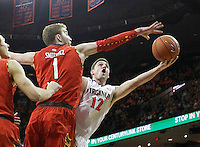 Virginia guard Joe Harris (12) has his shot blocked by Maryland forward Evan Smotrycz (1) during the game Monday night in Charlottesville, VA. Photo/The Daily Progress/Andrew Shurtleff