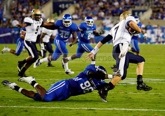 Defensive end Collins Ukwu tries to take down Patrick Nicely during the second half of  UK's win over  Akron at home on  Saturday, September 18, 2010. Photo by Britney McIntosh | Staff