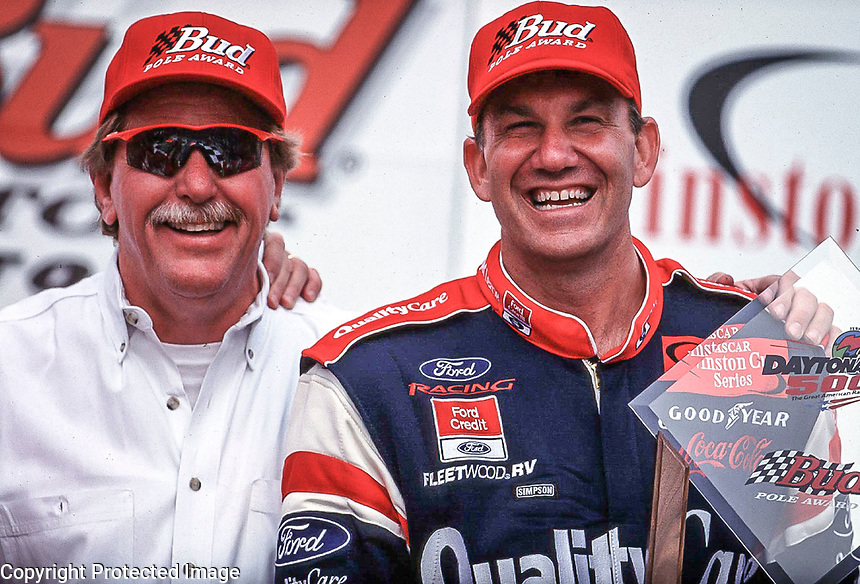 NASCAR driver Dale Jarret (right) and his car owner Robert Yates smile after winning the pole position for the Daytona 500 at Daytona International Speedway in Daytona Beach, FL 2/12/00.(Photo by Brian Cleary)