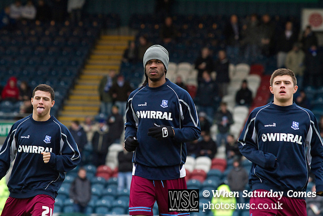 Rochdale 3 Tranmere Rovers 1, 01/01/2011. Spotland, League One. Tranmere Rovers players Dale Jennings, Ian Goodison and Aaron Cresswell on the pitch during the players' warm-up at Spotland Stadium, before the team's Npower League 1 fixture away to Rochdale. It was the first league fixture between the teams since March 1989. Rochdale won this latest encounter by three goals to two watched by a crowd of 5,500. Photo by Colin McPherson.