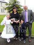 Sophia Cunningham Who received first holy communion in St Cianan's church Duleek with her family Sonya, Conleth and James.<br /> <br /> Photo-Jenny Matthews