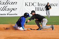 Bristol White Sox second baseman Jake Brown #8 tags out a hard sliding Gavin Cecchini #2 during a game against the Kingsport Mets at Hunter Wright Stadium on July 28, 2012 in Kingsport, Tennessee. The Mets defeated the White Sox 9-5. (Tony Farlow/Four Seam Images).