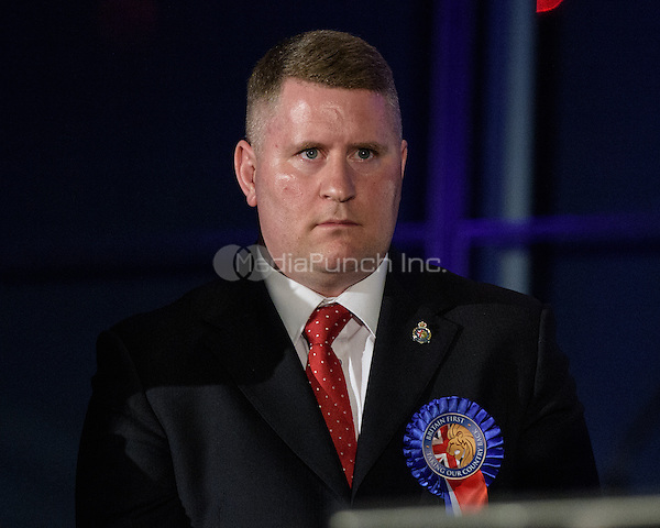 Britain First candidate Paul Golding turns  facing Sadiq Khan, the new London Mayor, after turning his back during the victory speech at the results announcement in London's City Hall, May 06, 2016. Photo by Andre Camara<br /> CAP/CAM<br /> &copy;CAM/Capital Pictures /MediaPunch ***NORTH AMERICAN AND SOUTH AMERICAN SALES ONLY***