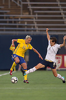 Sweden midfielder Josefine Oqvist (14) avoids tackle by US forward Megan Rapinoe (11). The US Women's national team beat Sweden, 3-0, at Rentschler Field on July 17, 2010.