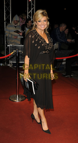 EMILY SYMONS.The British Academy Television Awards 2008 after party held at the Grosvenor House Hotel, London, England..April 20th 2008. .BAFTA BAFTA's full length black  dress.CAP/CAN.©Can Nguyen/Capital Pictures.