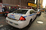 NYC, New York, U.S.  21st May 2013. A NYPD Police car and other vehicles such as taxis are in the street in front of the Broadway show The Lion King, at the Minskoff Theatre, during the dusk of a pleasant spring day, with a high of 86ºF/32ºC in Manhattan.