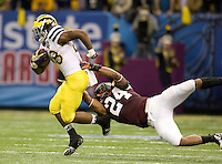 Tariq Edwards of Virginia Tech tackles Fitzgerald Toussaint of Michigan during Sugar Bowl game at Mercedes-Benz SuperDome in New Orleans, Louisiana on January 3rd, 2012.  Michigan defeated Virginia Tech, 23-20 in first overtime.