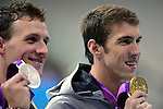 LONDON, ENGLAND - AUGUST 2:  Ryan Lochte (silver) and Michael Phelps (gold) hold their medals for the Men's 200M Individual Medley during the Swimming Final, Day 7 of the London 2012 Olympic Games on August 2, 2012 in London, England. (Photo by Donald Miralle)