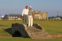 Damien McGrane (IRL) and his playing partner Pritesh Shah (AM) on the Swilcan Bridge on the 18th fairway during Round 2 of the 2015 Alfred Dunhill Links Championship at Kingsbarns in Scotland on 2/10/15.<br /> Picture: Thos Caffrey | Golffile