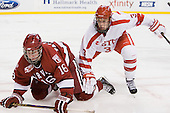 Alex Fallstrom (Harvard - 16), Charlie Coyle (BU - 3) - The Harvard University Crimson defeated the Boston University Terriers 5-4 in the 2011 Beanpot consolation game on Monday, February 14, 2011, at TD Garden in Boston, Massachusetts.