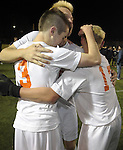 (Worcester Ma 111613) Belchertown 3,  Cameron Messier, left, celebrates with teammates after he scored the winning goal,  during the MIAA Division Three Boys Soccer Final between Belchertown High and Medway High, Saturday night at Foley Field in Worcester. (Jim Michaud Photo) For Sunday