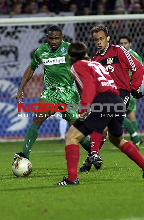 DFB Pokal 2002/2003 - Achtelfinale<br /> Bayer Leverkusen vs Waldhof Mannheim<br /> Emeka gegen Placente und Franca von Bayer Leverkusen<br /> Foto &copy; nordphoto <br /> <br /> *** Local Caption *** Foto ist honorarpflichtig! zzgl. gesetzl. MwSt.<br />  Belegexemplar erforderlich<br /> Adresse: nordphoto<br /> Georg-Reinke-Strasse 1<br /> 49377 Vechta