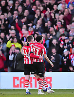 Lincoln City's Bruno Andrade celebrates scoring his side's second goal with Harry Toffolo, left<br /> <br /> Photographer Andrew Vaughan/CameraSport<br /> <br /> The EFL Sky Bet League Two - Lincoln City v Stevenage - Saturday 16th February 2019 - Sincil Bank - Lincoln<br /> <br /> World Copyright © 2019 CameraSport. All rights reserved. 43 Linden Ave. Countesthorpe. Leicester. England. LE8 5PG - Tel: +44 (0) 116 277 4147 - admin@camerasport.com - www.camerasport.com