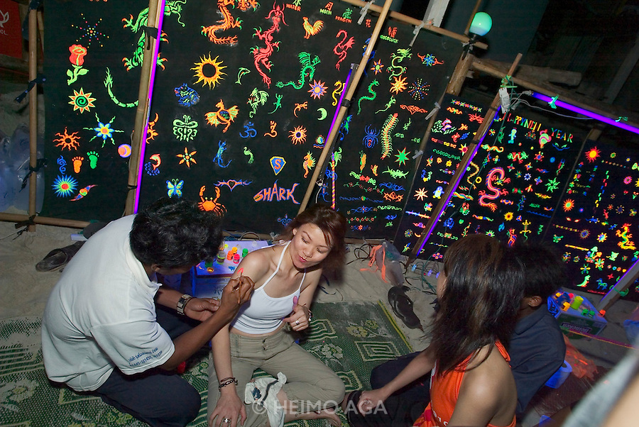 The notorious Full Moon Party at Hat Rin beach on the small Thai island of Ko Pha-Ngan is Asia's biggest regular rave event. Fluorescing body painting.