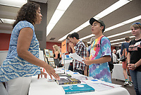 Tobias Larkin '21 talks with politics professor Regina Freer, Academic Department Information Fair in the Academic Commons.  Incoming first-years and their families are welcomed by O-Team members and the community at the start of Occidental College's Fall Orientation for the class of 2021, Aug. 24, 2017.<br /> (Photo by Marc Campos, Occidental College Photographer)