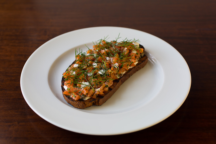 house cured salmon tartine, crème fraîche, fennel at Cafe Castagna, a restaurant in SE Portland, Oregon, USA